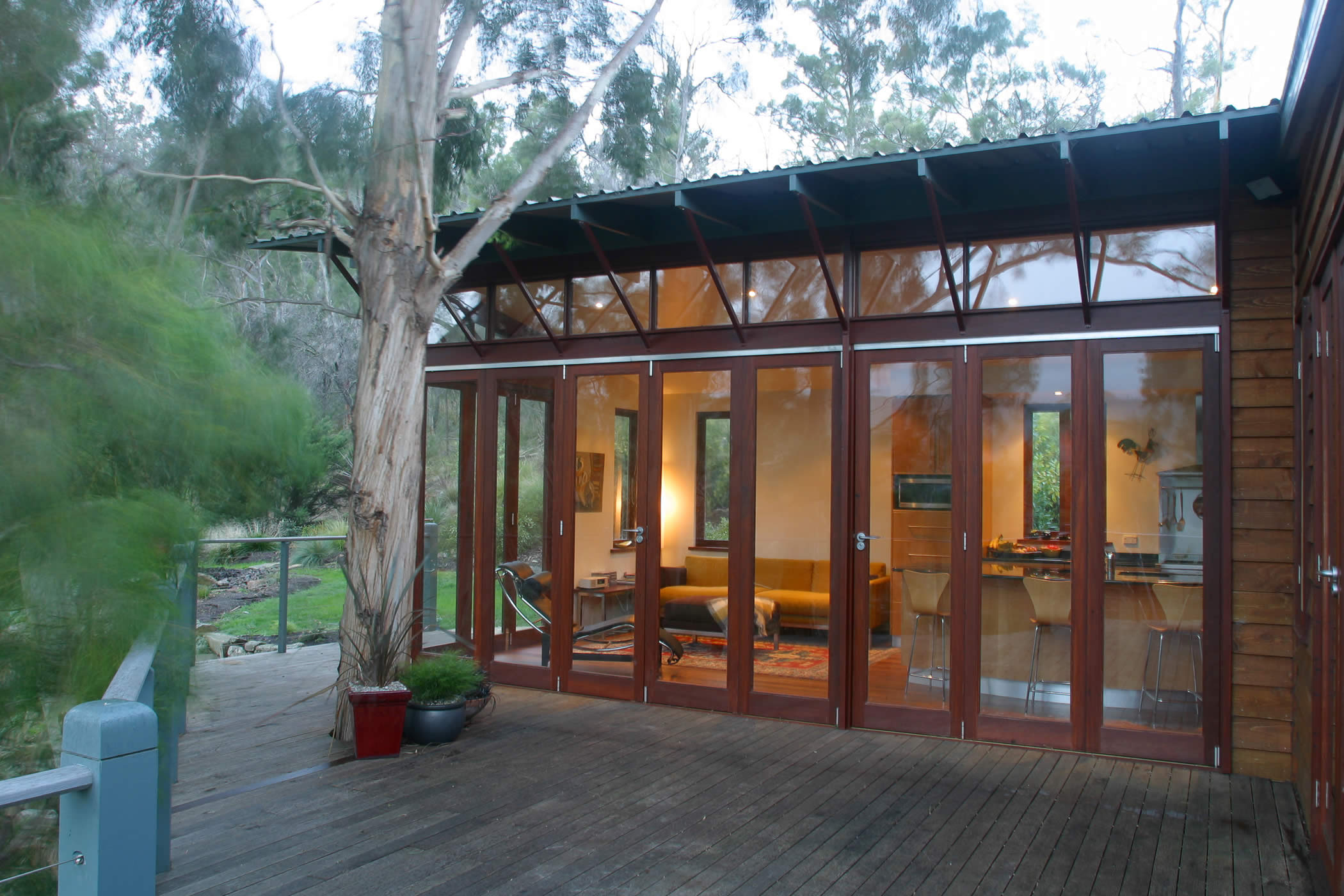 House Butler Extension: Glazed recycled hardwood (mixed eucalyptus) timber bi-fold doors and high-level windows bring the outside in. Photo by Peter Whyte.