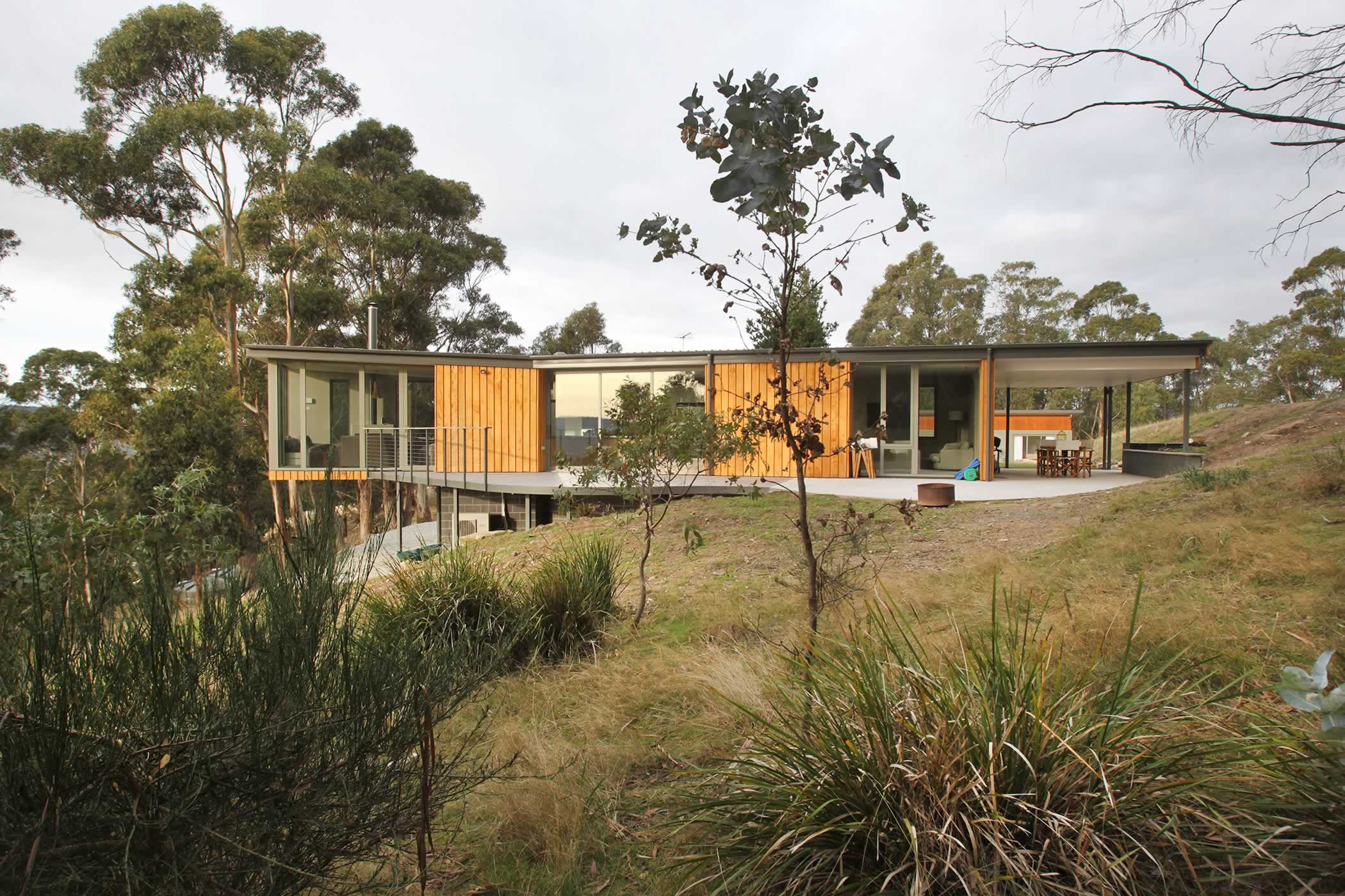 Jamieson Road Residence, Tasmania: Dramatically extending into space for elevated views, the plan is also orientated for optimal passive solar gain and an easy indoor-outdoor connection to meet our clients' varied lifestyle needs. Photo by R. Lovell.