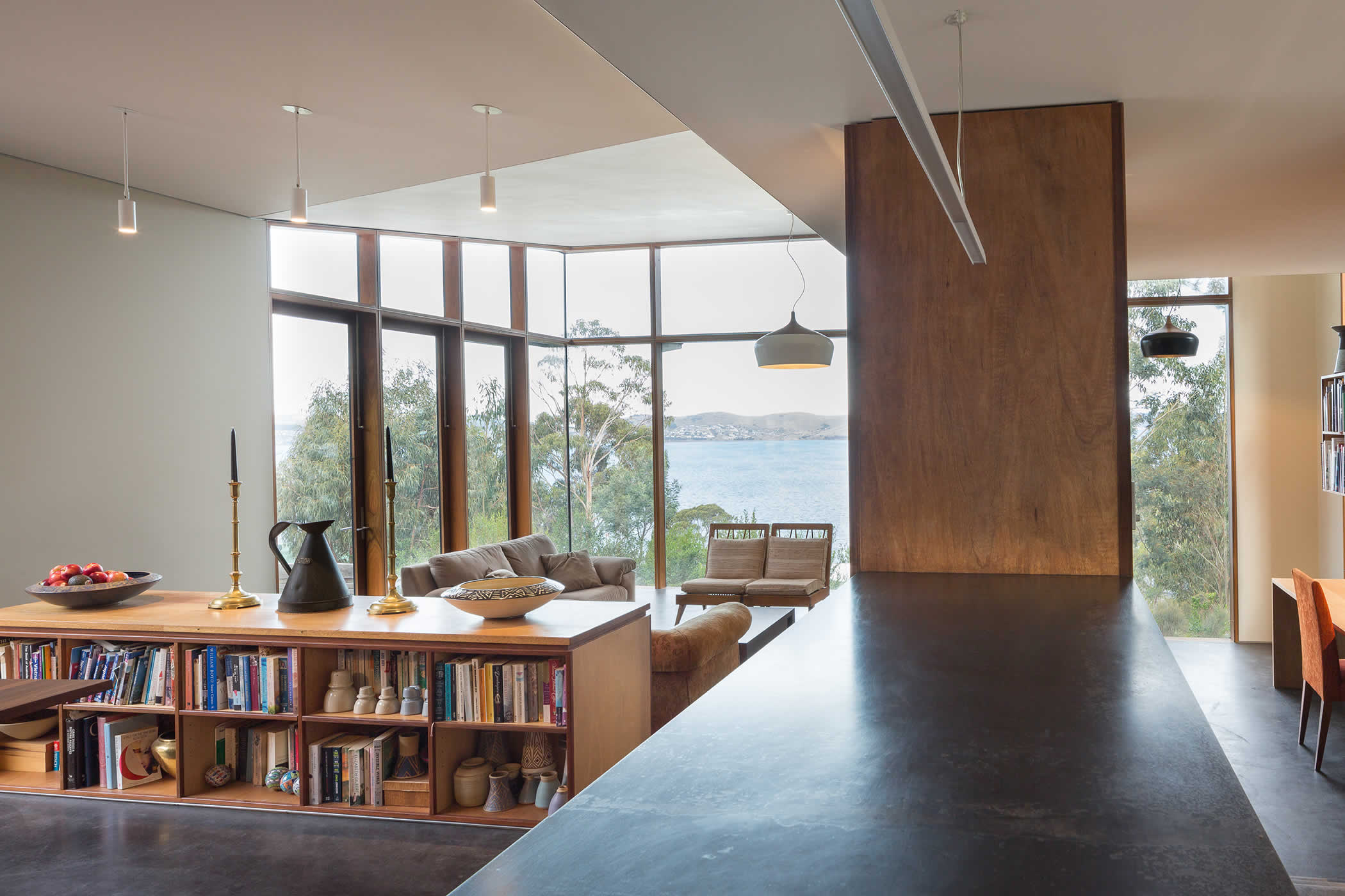 Sandy Bay, Tasmania: The main pavilion opens to the courtyards and different views. Floor and ceiling levels, alcoves and clever storage define interlinked dining, living, study, kitchen and pantry / laundry space. Photo by Thomas Ryan.